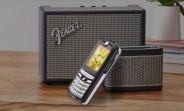 The Motorola E398 (aka ROKR E1) could vibrate with sound too
