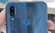 Blue Huawei P20 Lite poses for a photo