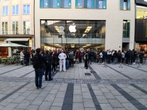 People in Munich waiting to check out the new iPhones
