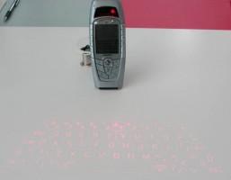"Siemens SX1 laser keyboard prototype <a href=""https://www.golem.de/0403/30350.html"" target=""_blank"" rel=""noopener noreferrer"">image credit</a>"