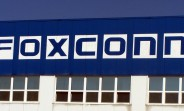 Production at Foxconn beats expectations, slow market a worry