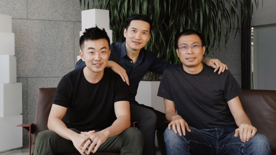 Carl Pei (left) with Pete Lau (middle)
