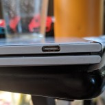 User photos of cracks in the plastic around the USB-C port