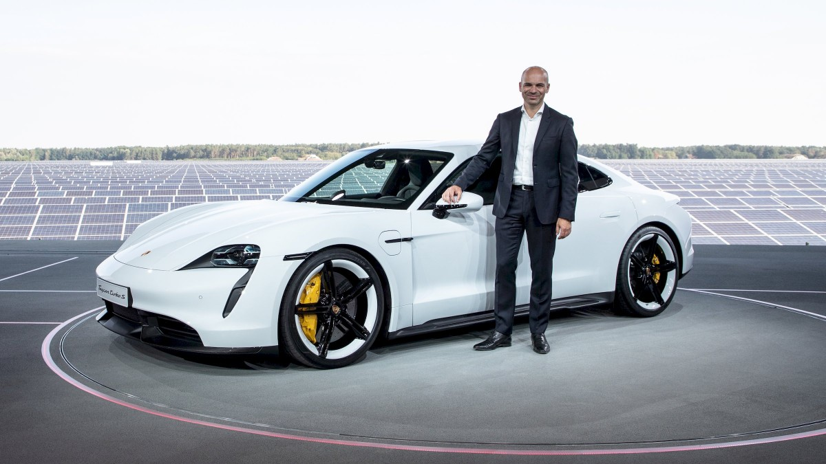 Manfred Harrer, Vice President of Chassis Development, presenting the Porsche Taycan