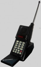 "Motorola MicroTAC <a href=""https://en.wikipedia.org/wiki/File:Motorola_MicroTAC_9800x.jpg"" target=""_blank"" rel=""noopener noreferrer"">image credit</a>"