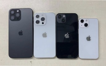 Four iPhone 13 dummies pose for a photo