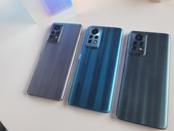 Three units of the upcoming Infinix phone showing off different colorways